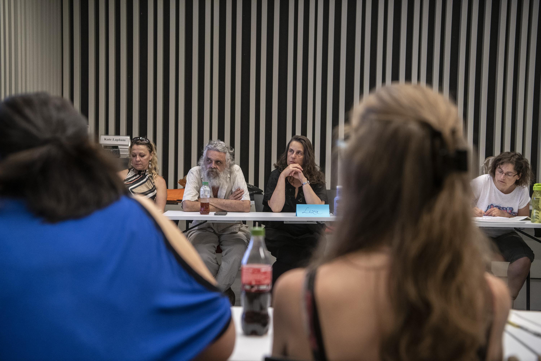 Socrates course participants in discussion